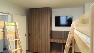 A television and/or entertainment center at Eazy Hostel Heidelberg