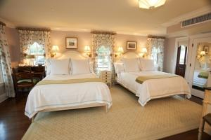 A bed or beds in a room at Saybrook Point Resort & Marina