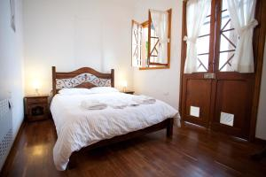 A bed or beds in a room at Arche Noah Boutique Hostel