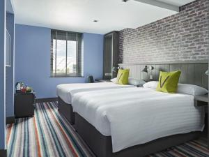 A bed or beds in a room at Village Hotel Glasgow