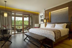 A bed or beds in a room at Padma Resort Ubud