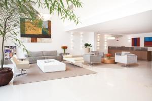The lobby or reception area at Ramada Hotel & Suites Campos Pelinca