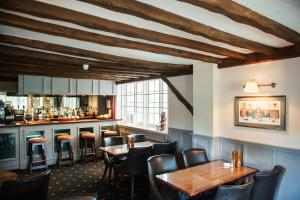 A restaurant or other place to eat at Findon Manor Hotel