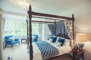 A bed or beds in a room at Findon Manor Hotel