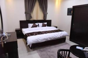 Cama ou camas em um quarto em Talah Aparthotel