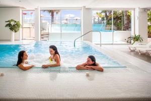 The swimming pool at or near Hotel Caravelle Thalasso & Wellness