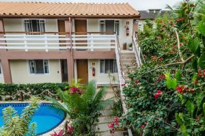 Uma vista da piscina em Pousada Vila da Praia ou nos arredores