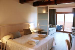 Letto o letti in una camera di Hotel Marana