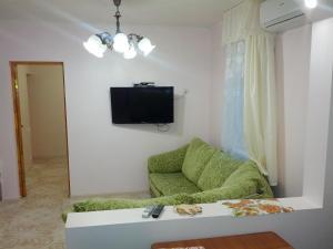 Телевизор и/или развлекательный центр в Apartment Na Sverdlova