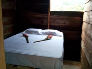 A bed or beds in a room at Posada la Ofelia