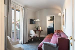 A seating area at Tornabuoni Suites Collection Residenza D'Epoca