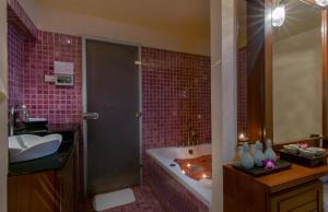A bathroom at The Sukosol Hotel Bangkok