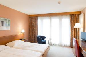 Кровать или кровати в номере Hotel Le Cedre