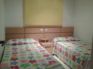 Cama o camas de una habitación en Costa Azahar Apartments Beach