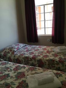 A bed or beds in a room at Casa da Ponte Hotel