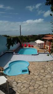 A piscina localizada em Pousada Zekas ou nos arredores