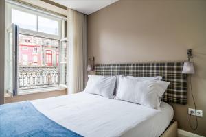Uma cama ou camas num quarto em Mouzinho 160