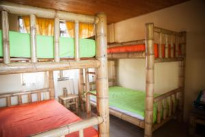 A bunk bed or bunk beds in a room at Panorama Café Hostel