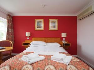 A bed or beds in a room at The Chatsworth Hotel