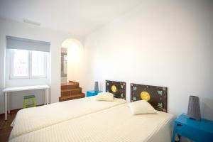 Cama ou camas em um quarto em HI Évora – Pousada de Juventude