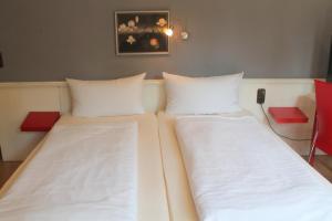 Кровать или кровати в номере Hotel Doerenkamp