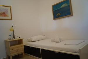 A bed or beds in a room at Μyrsini