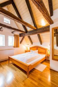 Кровать или кровати в номере Boutique- und Businesshotel Herrenküferei