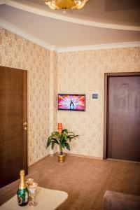 Телевизор и/или развлекательный центр в Отель «Империя»