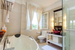 Ein Badezimmer in der Unterkunft Maison Souvannaphoum Hotel
