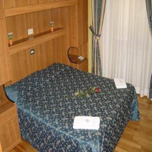 Кровать или кровати в номере Hotel Mari 2