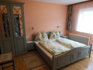 Postel nebo postele na pokoji v ubytování Ferienwohnung Dirlinger by Schladmingurlaub