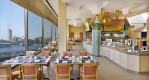 A restaurant or other place to eat at Ramses Hilton Hotel & Casino