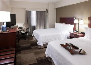 A bed or beds in a room at Hampton Inn & Suites Boise-Downtown