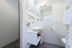 Et badeværelse på Einzigartig - Das kleine Hotel im Wasserviertel
