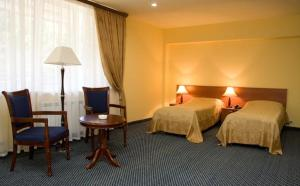 A bed or beds in a room at Hotel Dilijan Resort