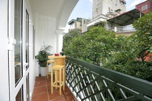 A balcony or terrace at Hanoi Chic Boutique Hotel