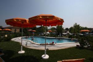 The swimming pool at or near Lucciole Nella Nebbia