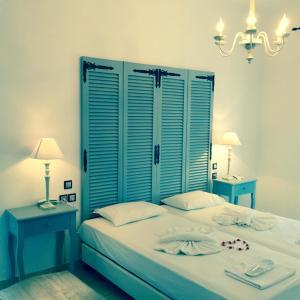 Letto o letti in una camera di Aphrodite Boutique Hotel