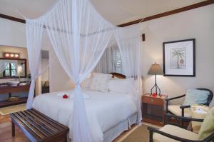 Ein Bett oder Betten in einem Zimmer der Unterkunft Victoria House Resort & Spa