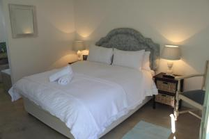 A bed or beds in a room at Over the Moon