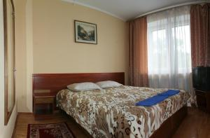 A bed or beds in a room at Morozko