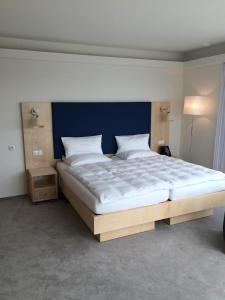 Кровать или кровати в номере Hotel Erwin Junker