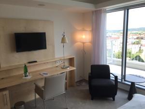 Телевизор и/или развлекательный центр в Hotel Erwin Junker