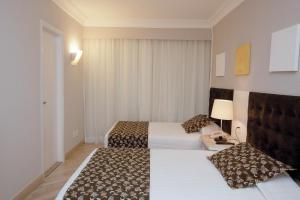 A bed or beds in a room at Bristol International Airport Hotel