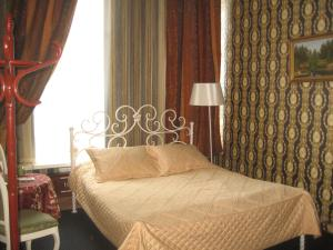 Кровать или кровати в номере Отель Титул