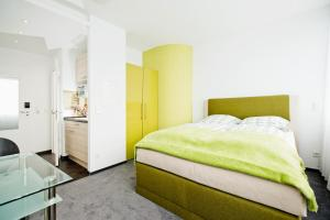A bed or beds in a room at Design Sleepy Cologne