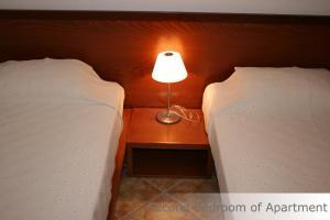 Letto o letti in una camera di Eye Q Resort