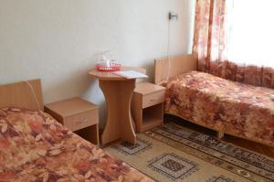 Кровать или кровати в номере Пансионат Балтика