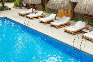 The swimming pool at or close to Fridays Boracay Beach Resort