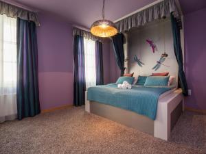 A bed or beds in a room at Lovely Prague Apartments - Truhlářská